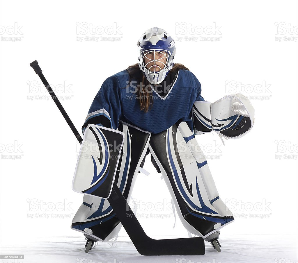 Young ball hockey goalie in blue jersey. stock photo
