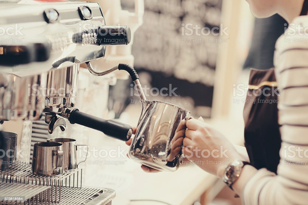 Young barista is preparing a coffee stock photo