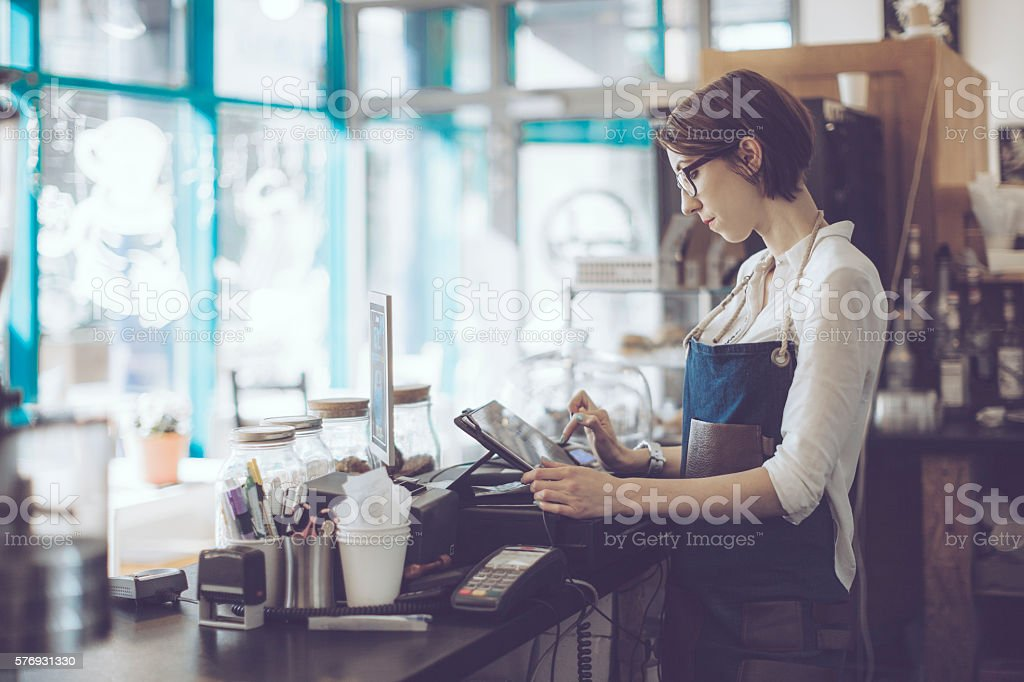 Young barista is working in a café stock photo