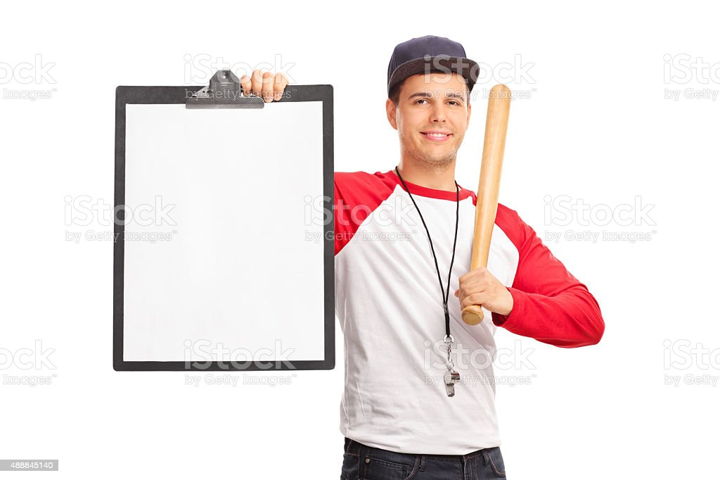 Young baseball coach holding a clipboard stock photo