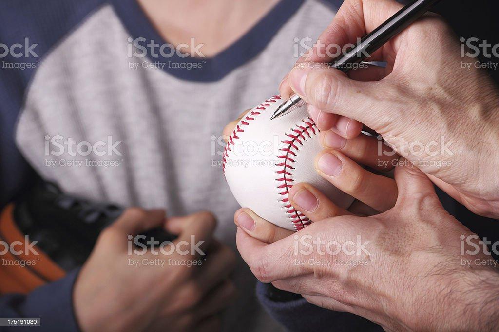Young baseball fan getting an autograph stock photo