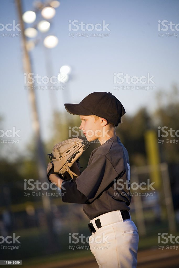 young baseball pitcher with stadium lights royalty-free stock photo
