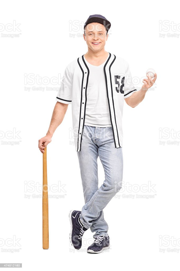 Young baseball player posing with bat and a ball stock photo