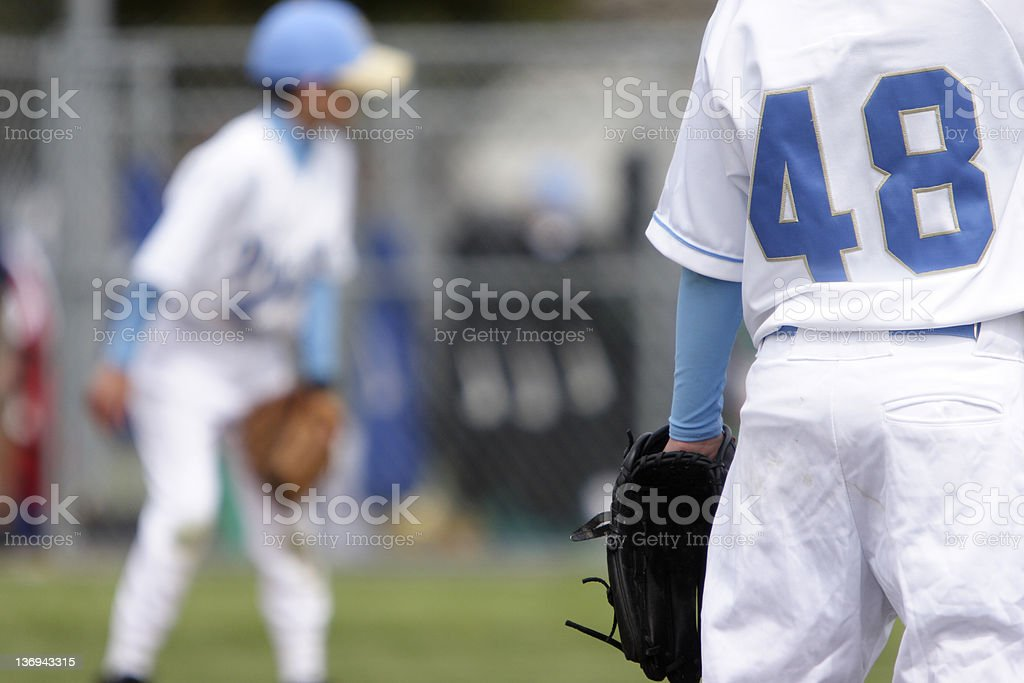 Young baseball players stock photo