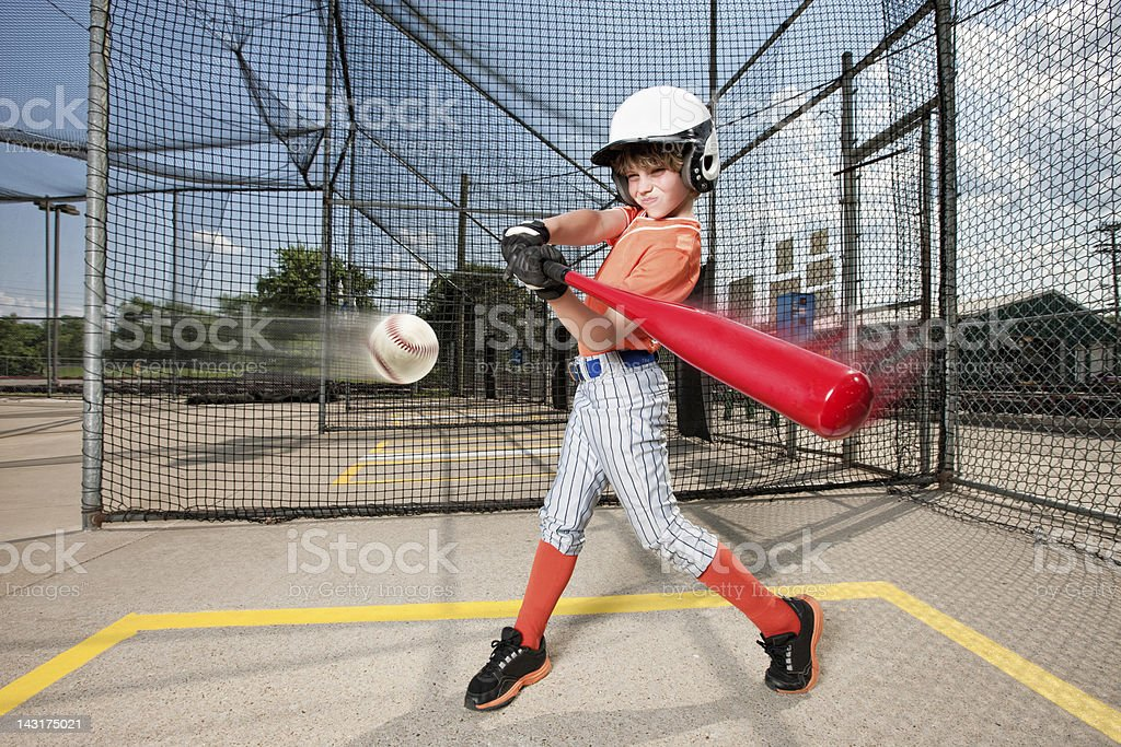 Young Baseball Swing in Batting Cage stock photo