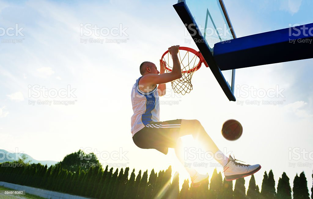 Young basketball player drives to the hoop stock photo