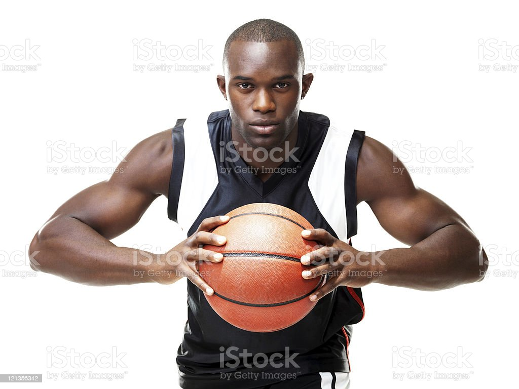 Young basketball player gripping the ball tight royalty-free stock photo