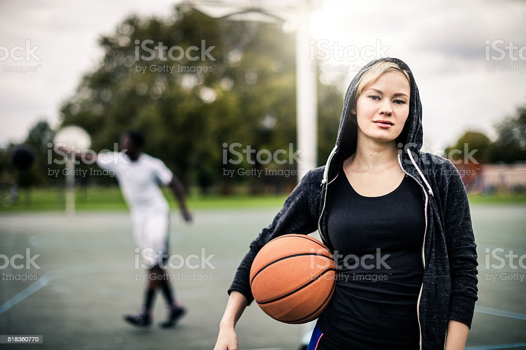 Young basketball player posing at the playground in London stock photo