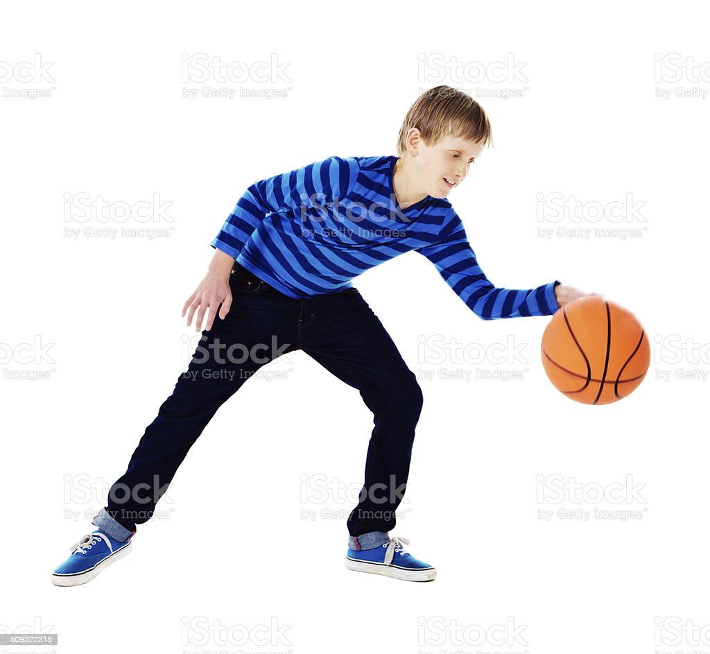 Young basketball player practises dribbling and ball control stock photo