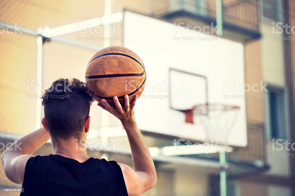 young basketball player ready to shoot stock photo