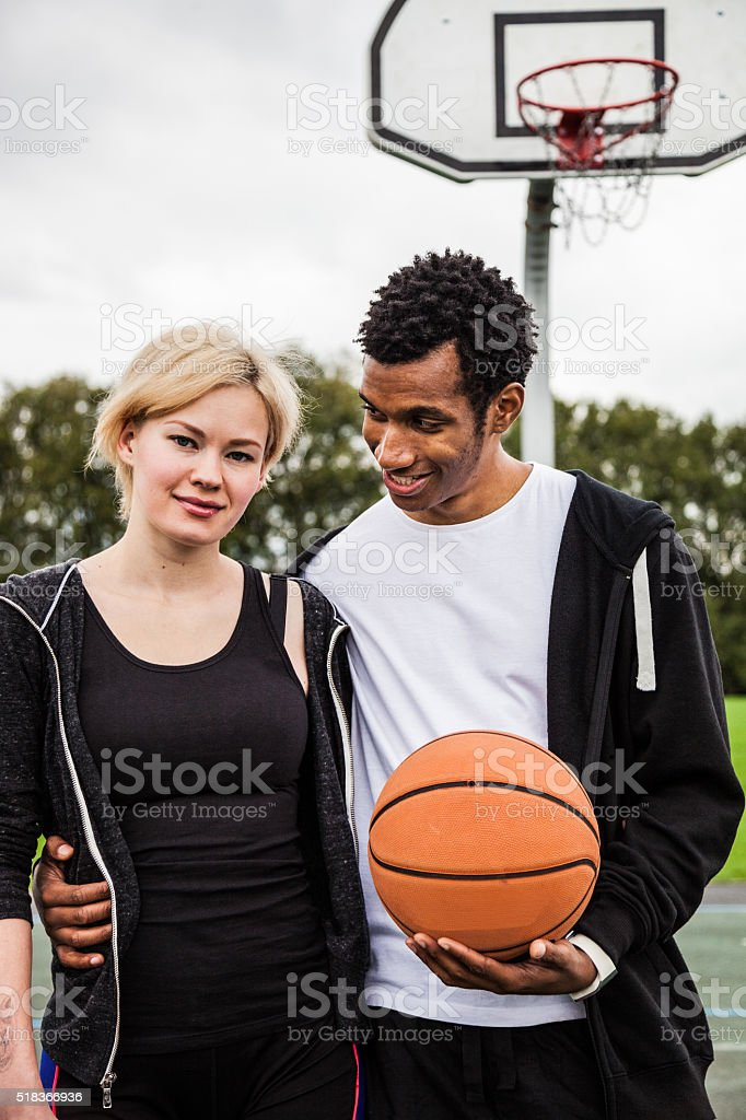 Young basketball players posing at the playground in London stock photo