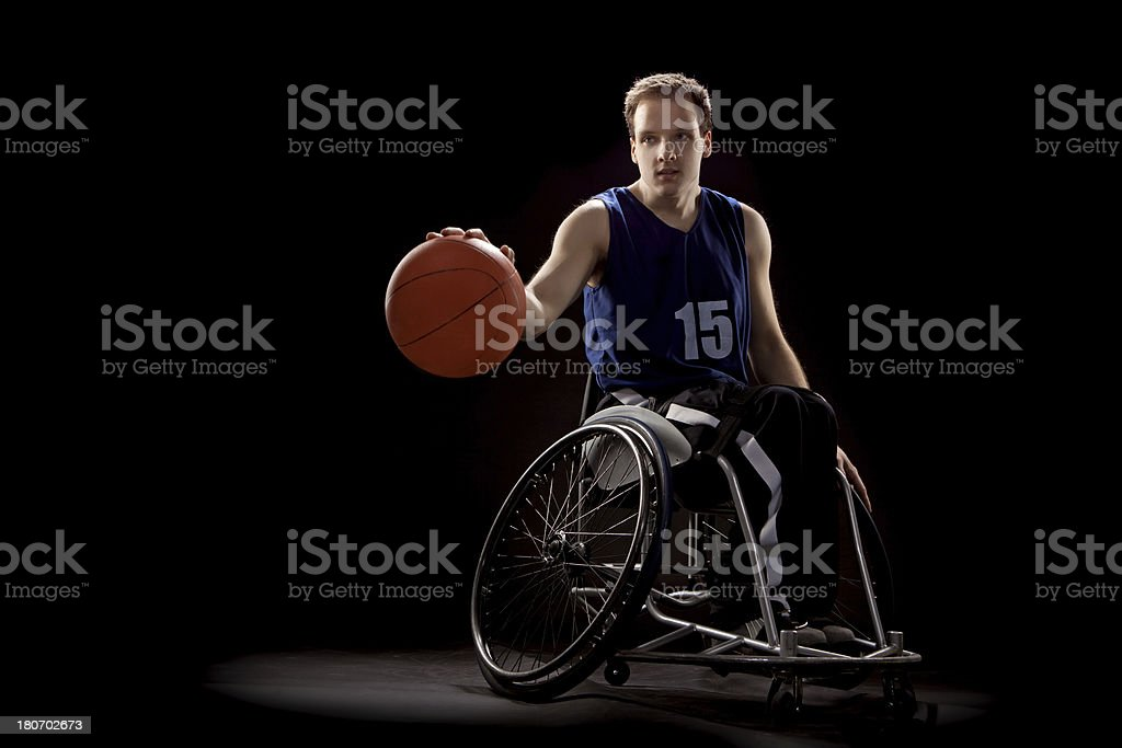young basketball wheelchair player stock photo