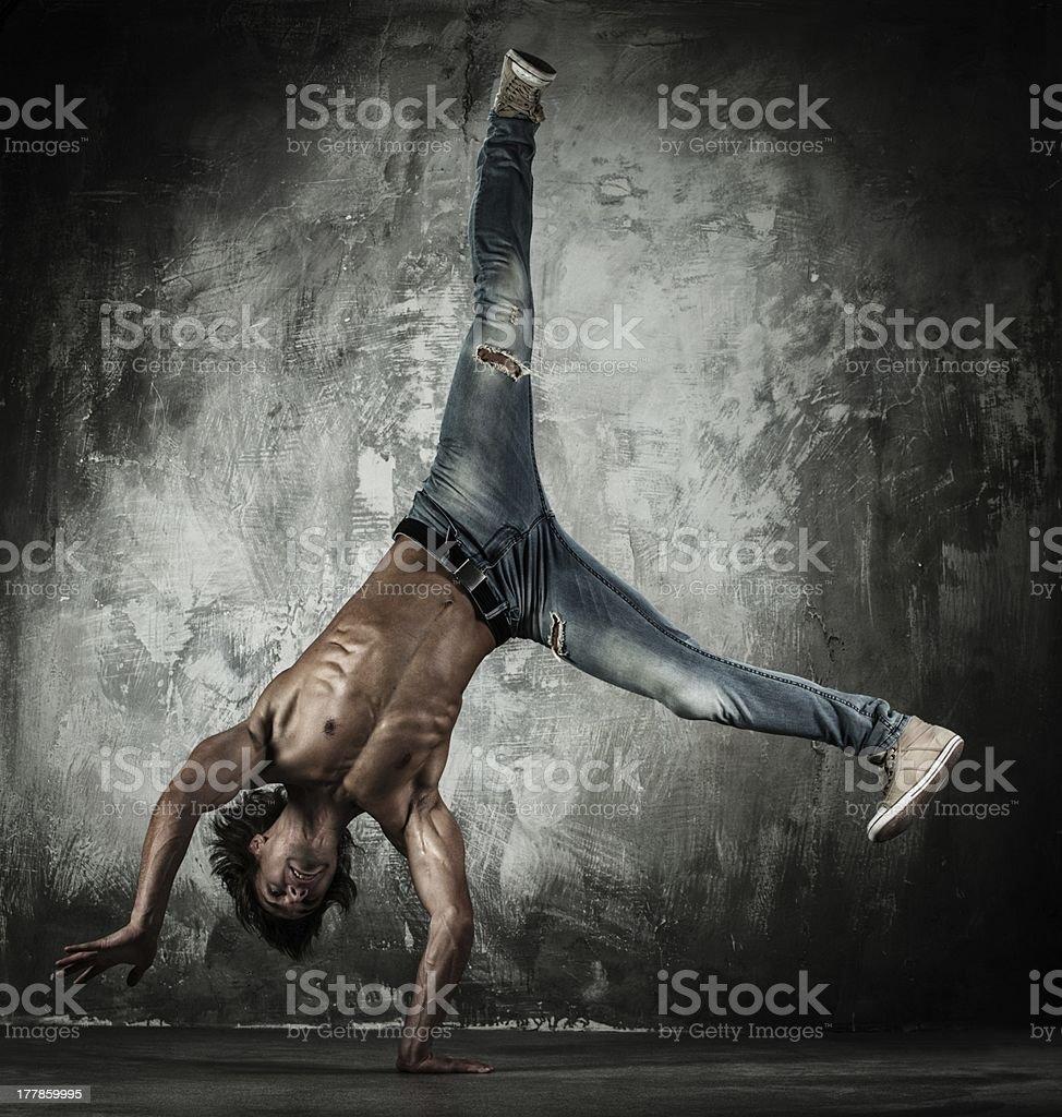 Young b-boy doing brake dancing movements royalty-free stock photo