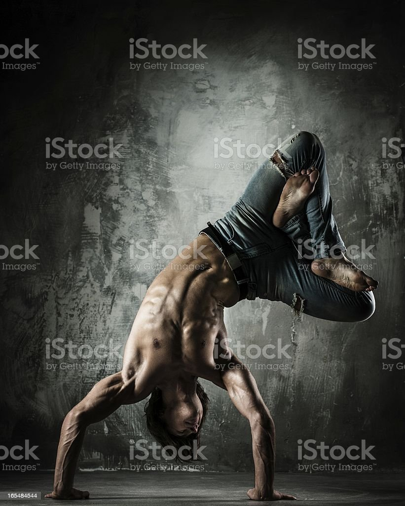 Young b-boy man doing brake dancing movements royalty-free stock photo