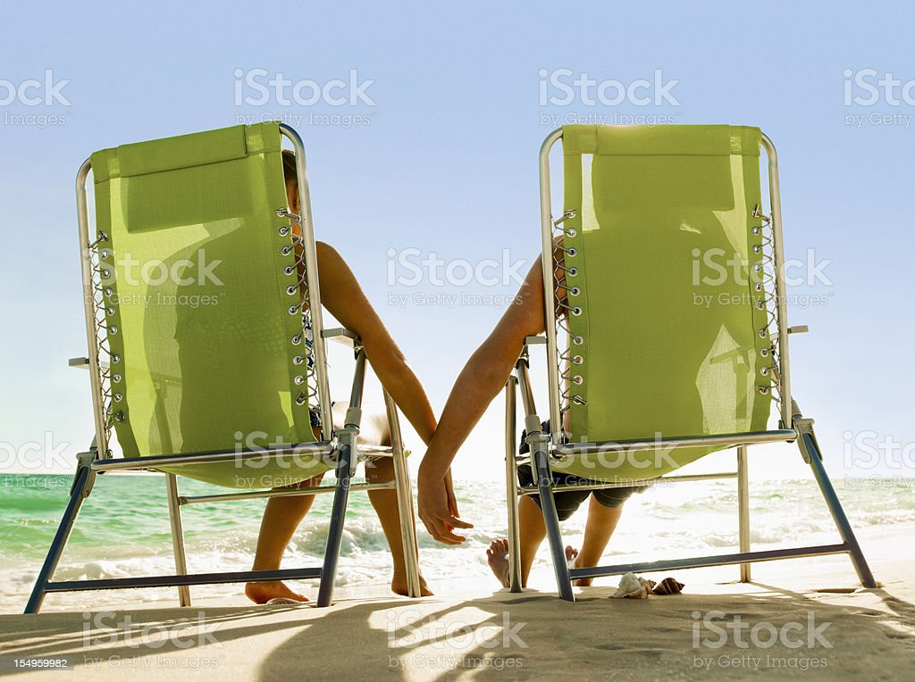 Young Beach Chair Couple royalty-free stock photo