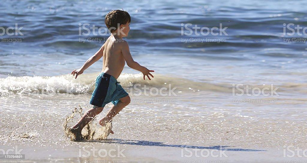 Young beach runner stock photo