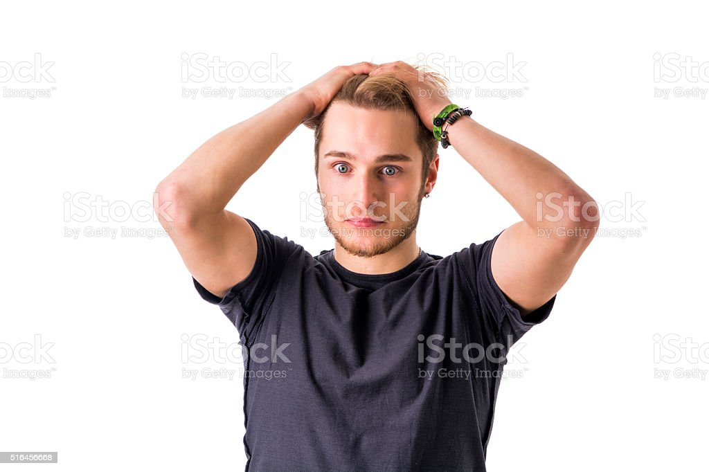 Young bearded man confused and shocked stock photo