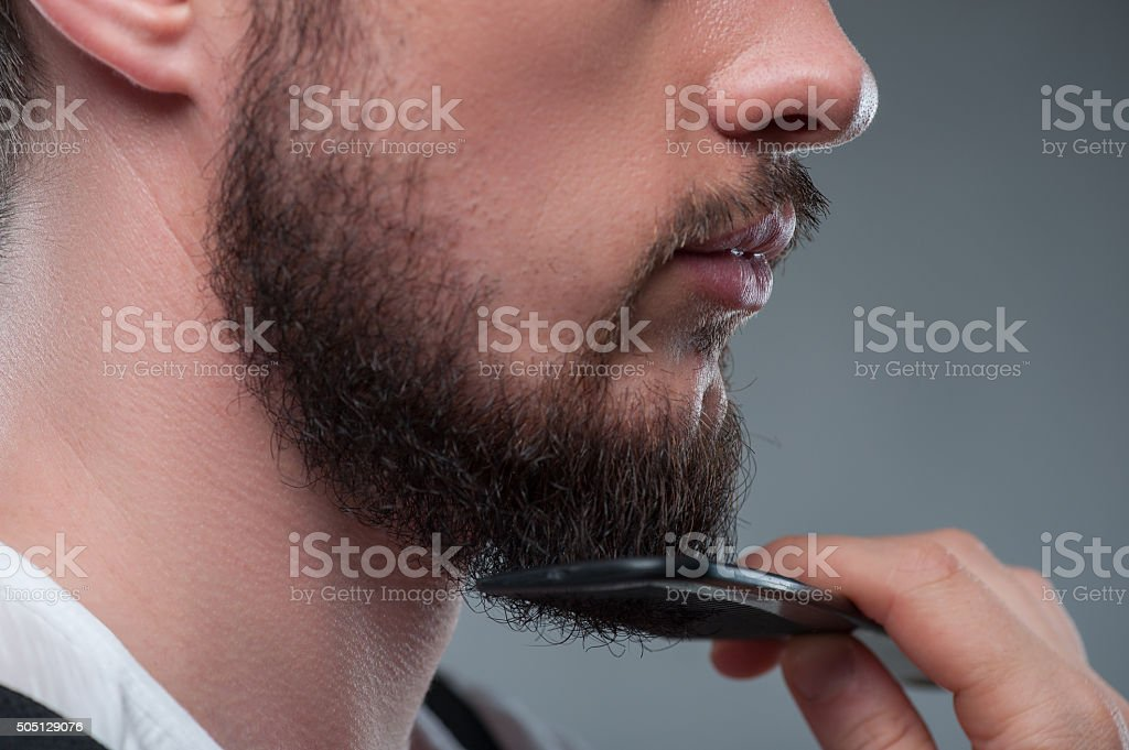 Young bearded man is preparing his image stock photo