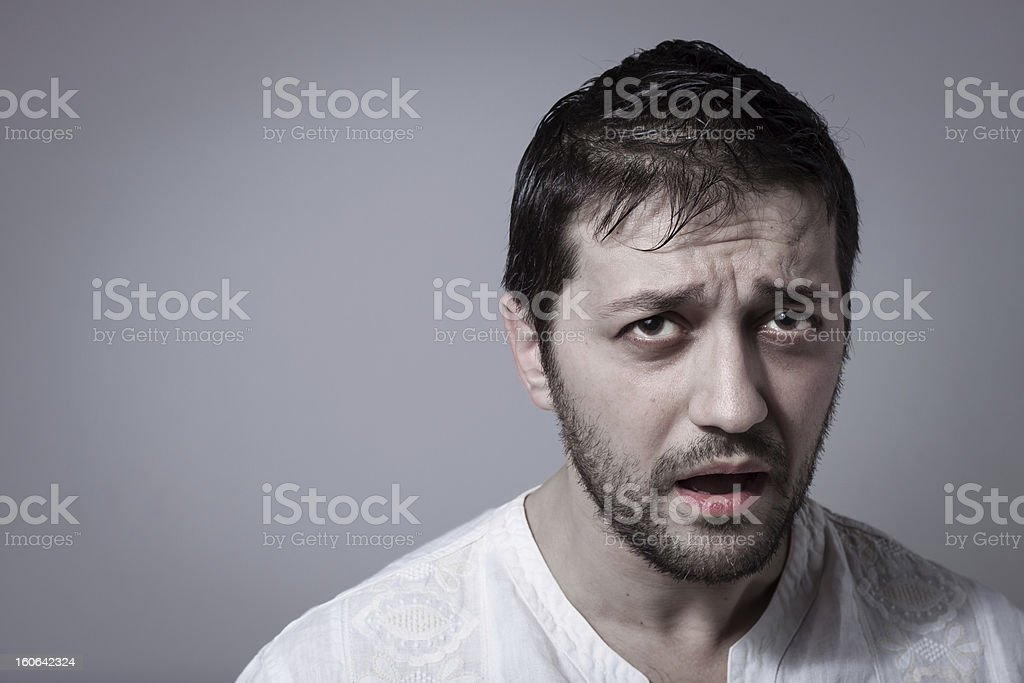 Young bearded man looking sick stock photo