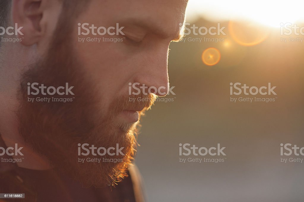 young bearded man with eyes closed stock photo