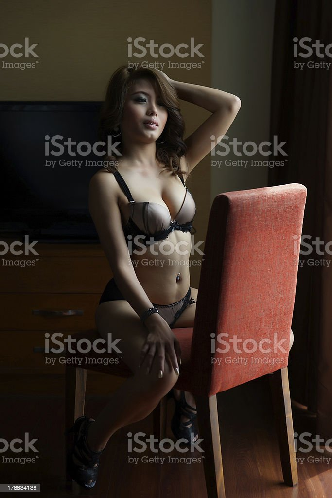 Young beautiful Asian woman in sexy lingerie royalty-free stock photo
