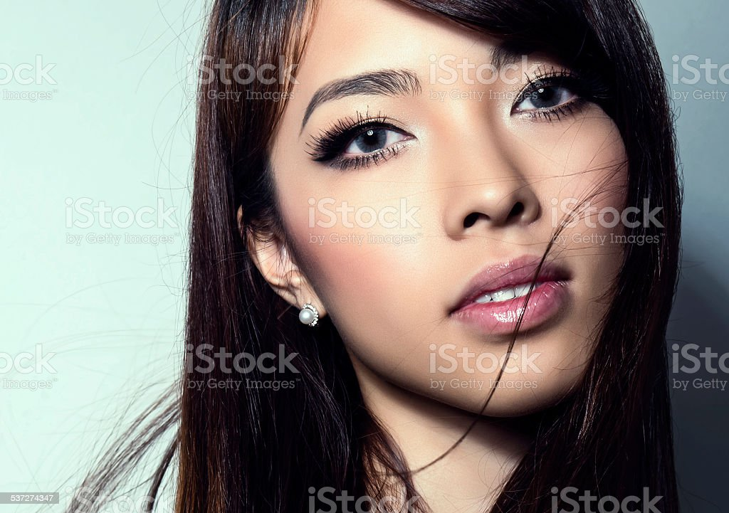 Young beautiful asian woman with flawless skin and perfect make-up stock photo