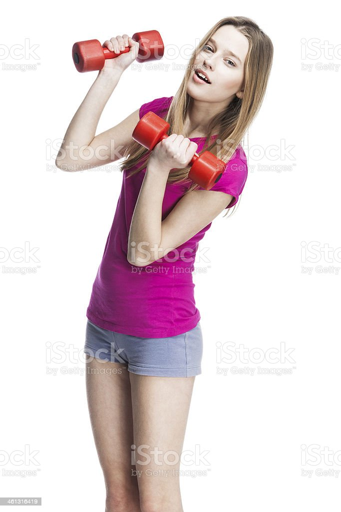 young beautiful blond girl holding dumbbells stock photo