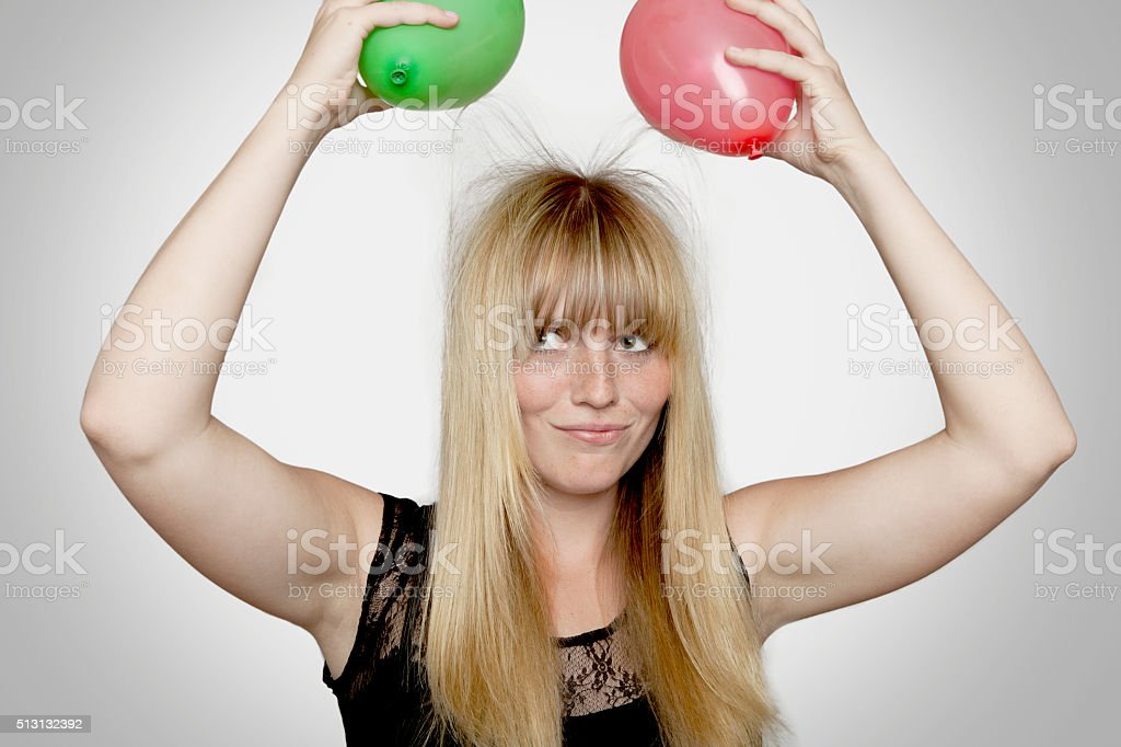 young beautiful blond haired girl with electric loaded balloons stock photo