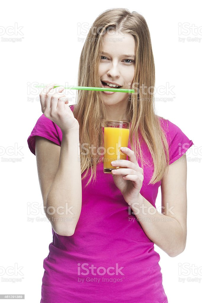 young beautiful blond woman holding glass of orange juice royalty-free stock photo