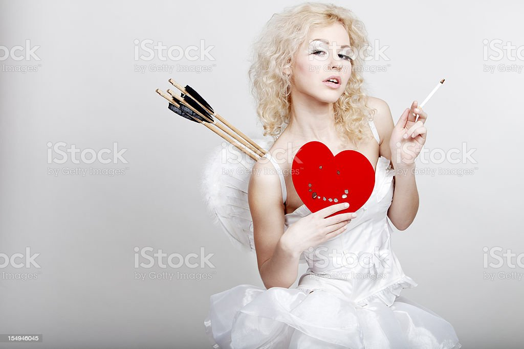 young beautiful blond woman in angel costume holding hardened he stock photo