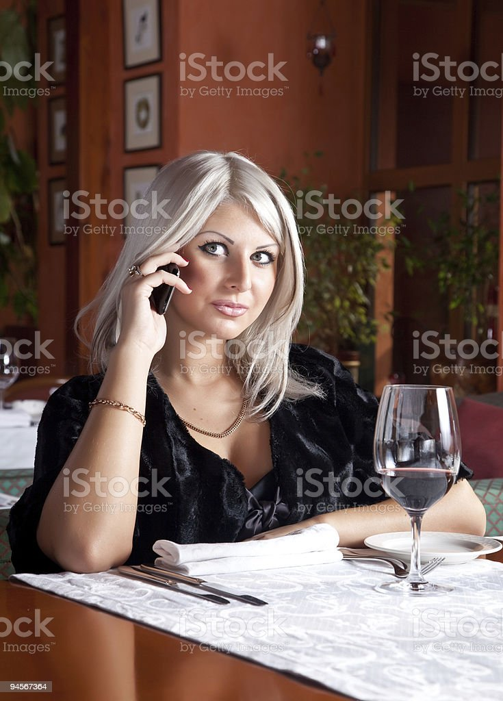 Young beautiful blond woman with the phone royalty-free stock photo