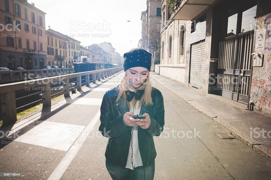 young beautiful blonde straight hair woman stock photo