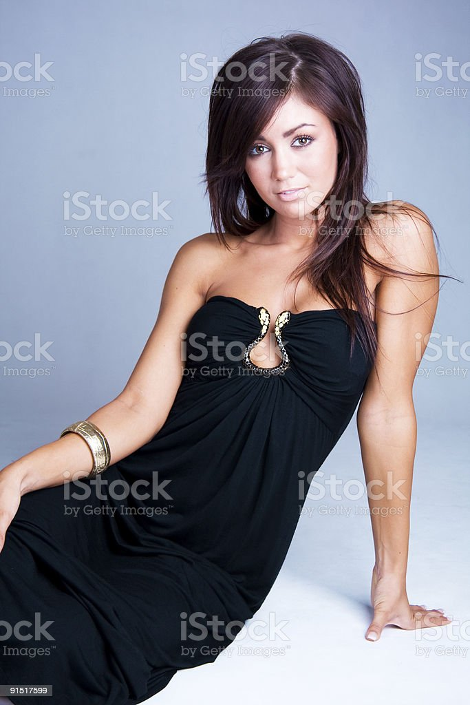 young beautiful brunette in a black dress royalty-free stock photo