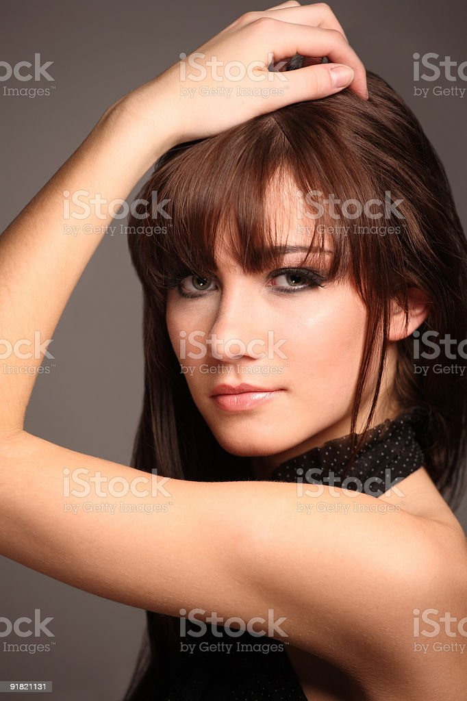 Young beautiful brunette model posed headshot royalty-free stock photo