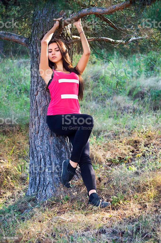 Young beautiful brunette model posing in the sports image stock photo