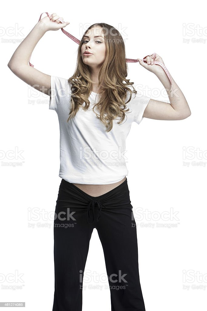 young beautiful brunette woman holding meter royalty-free stock photo