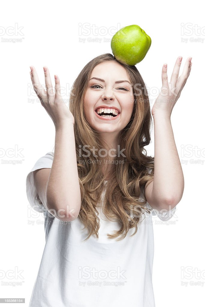 young beautiful brunette woman with green apple royalty-free stock photo
