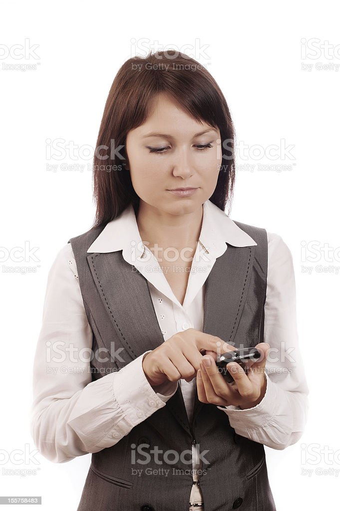 Young beautiful business woman dials a mobile phone royalty-free stock photo