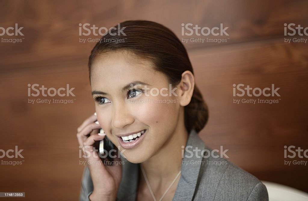 Young beautiful business woman on cell phone. royalty-free stock photo