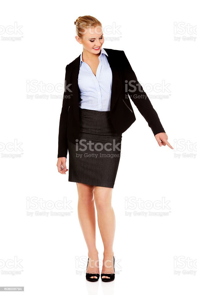 Young beautiful business woman pointing down stock photo