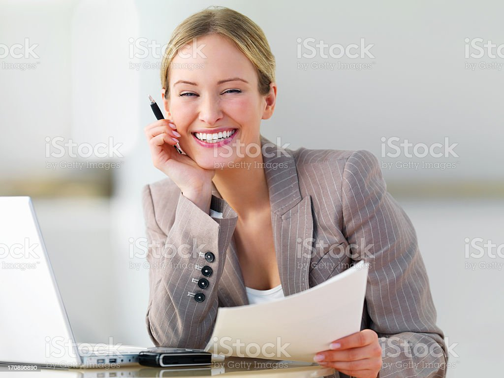Young beautiful business woman smiling royalty-free stock photo