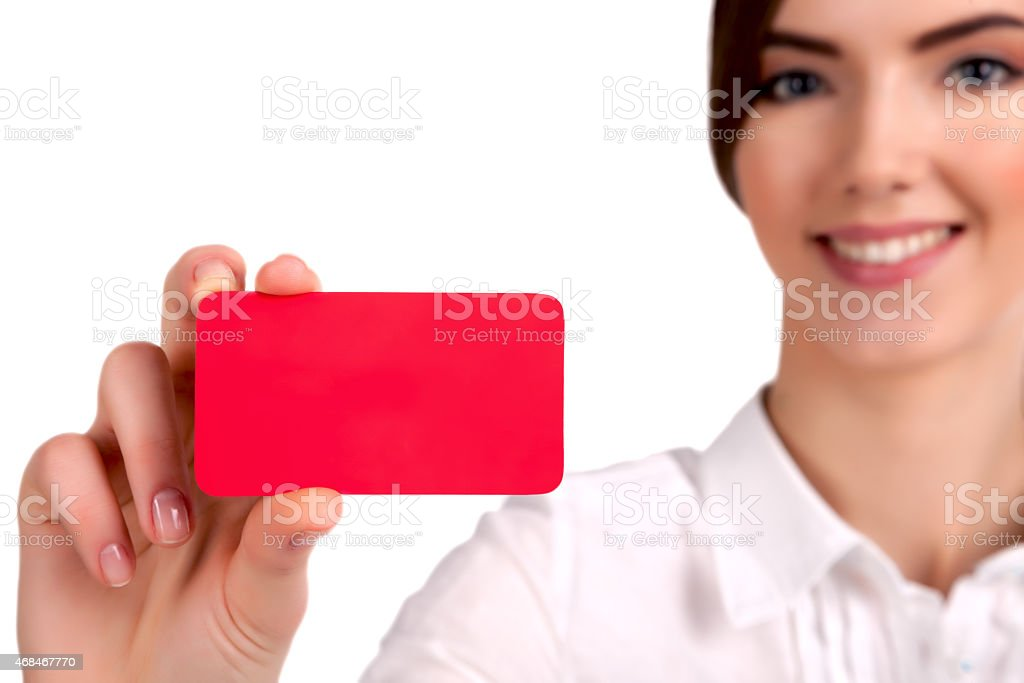 Young Beautiful Businesswoman holding a red business card stock photo