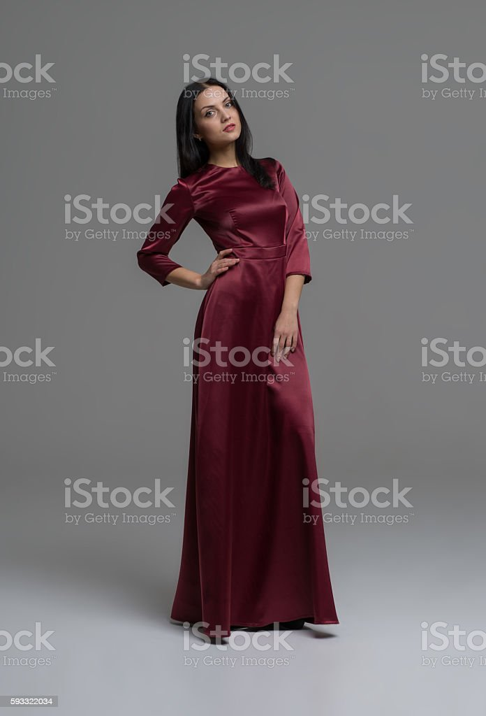 Young beautiful caucasian brunette in gorgeous dress stock photo