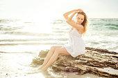 young beautiful caucasian female enjoying the sun on beach