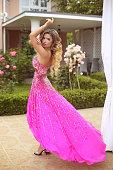 Young beautiful caucasian woman in gorgeous dress. blond girl