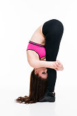Young beautiful caucasian woman in yoga pose on white