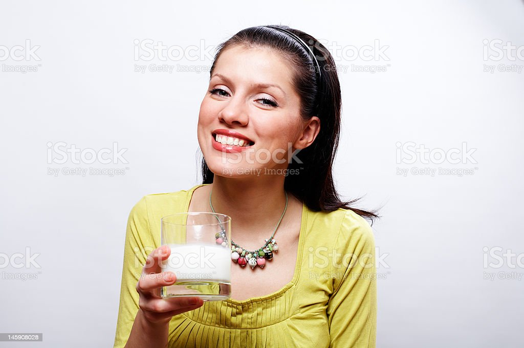 young beautiful causacian woman with glass of milk stock photo