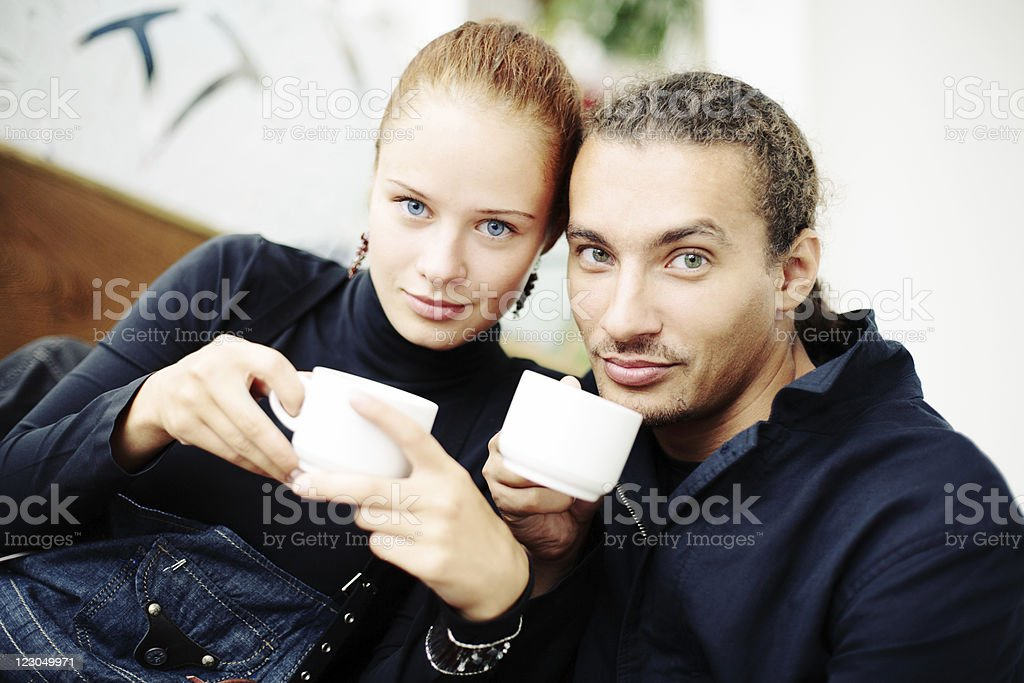 Young beautiful couple drinking tea royalty-free stock photo