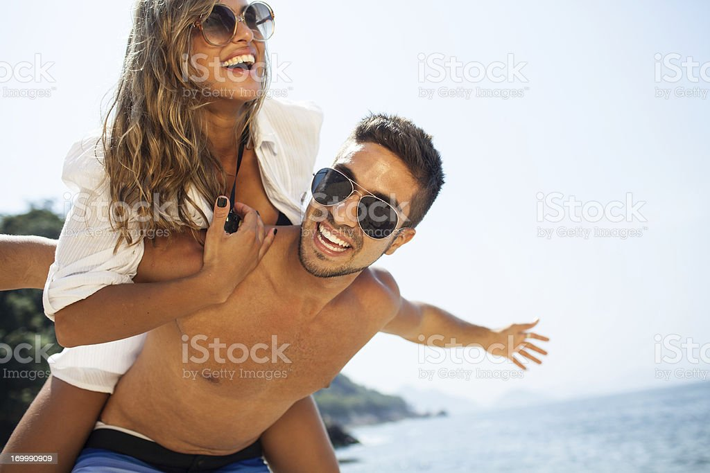 Young beautiful couple have fun at the beach. royalty-free stock photo
