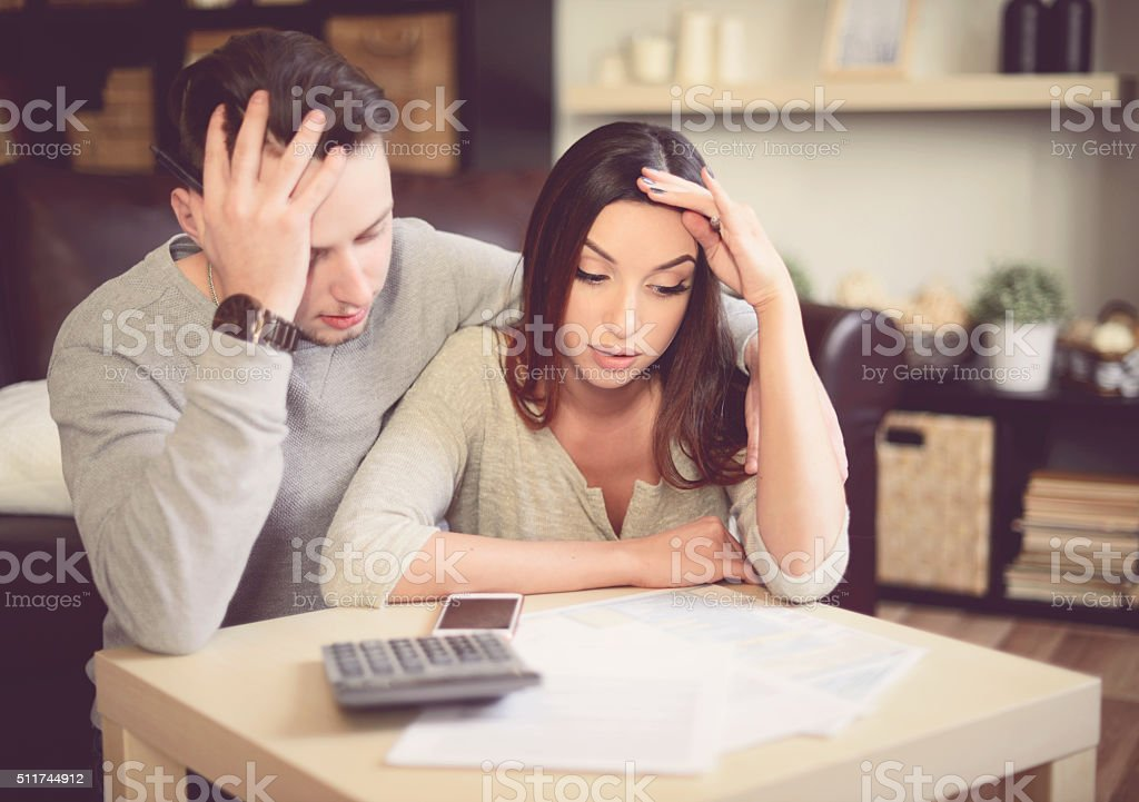 Young beautiful couple in home interior stock photo